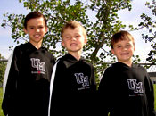 Photo of three young boys wearing sweatshirts with a Griz logo