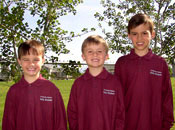 Photo of three young boys wearing long-sleeve polo shirts with a Griz logo